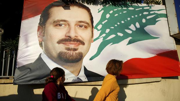 Saad Hariri on a poster in Beirut (AP/Hassan Ammar)