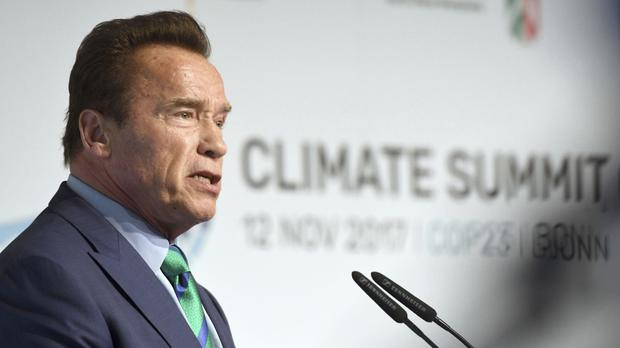 Arnold Schwarzenegger talks in the