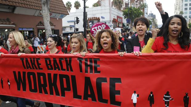 Crowds march against sexual assault and harassment in Hollywood (AP Photo/Damian Dovarganes)