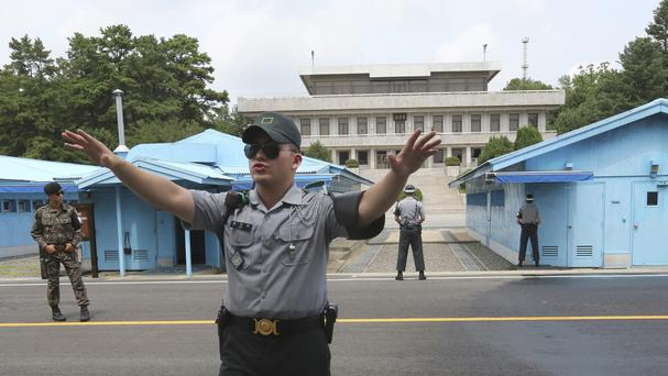 A South Korean army soldier gestures at the border village of Panmunjom in Paju, South Korea (Stock image - AP)