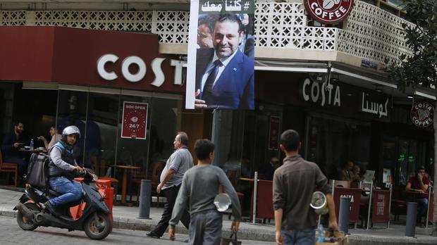 A poster of resigned Lebanese prime minister Saad Hariri which says
