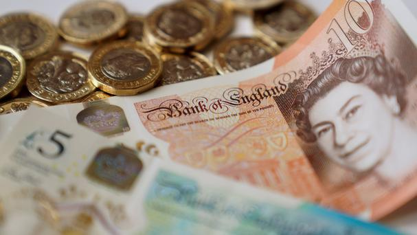 A picture of money, as share in Ultra Electronics fall on the London Stock Exchange (PA)