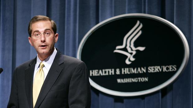 Alex Azar meets reporters at the HHS Department in Washington (AP)