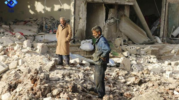 People inspect damage from air strikes in Atareb town, in the western Aleppo countryside (Thiqa News via AP)