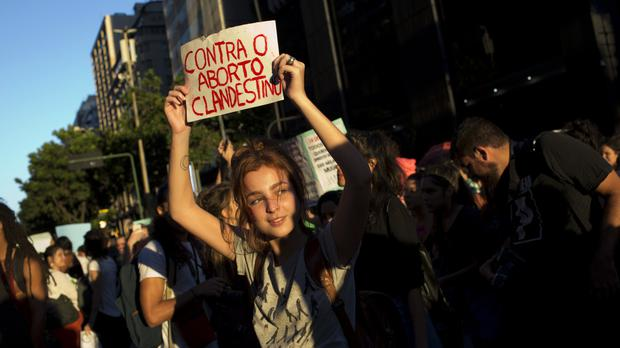 Thousands of women took to the streets of Rio de Janeiro to protest against a total ban on abortion (AP Photo/Silvia Izquierdo)