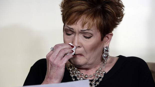 Beverly Young Nelson, the latest accuser of Alabama Republican Roy Moore, reads her statement at a news conference in New York (AP Photo/Richard Drew)