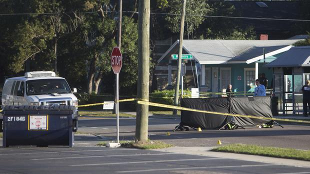 Law enforcement agents investigate a fatal shooting in the Seminole Heights area of Tampa (Jones, Octavio/Tampa Bay Times/AP/PA)