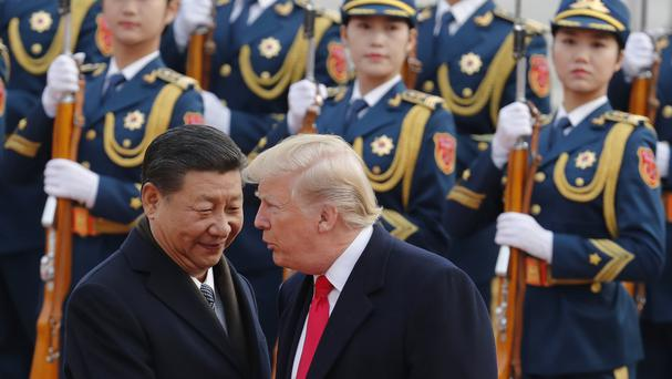 Donald Trump chats with Chinese leader Xi Jinping during the president's extensive tour of Asia