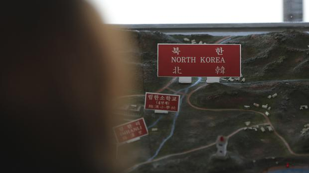 A visitor at the unification observatory in Paju, South Korea (AP)