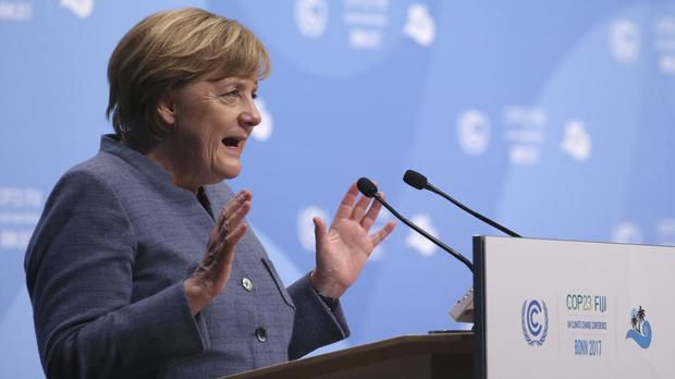 Angela Merkel delivers a speech during the 23rd Conference of the Parties (COP) climate talks in Bonn (Oliver Berg/dpa/AP/PA)