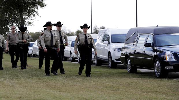 Mourners arrive at the Floresville Event Center to attend a funeral for members of the Holcombe family (AP Photo/Eric Gay)