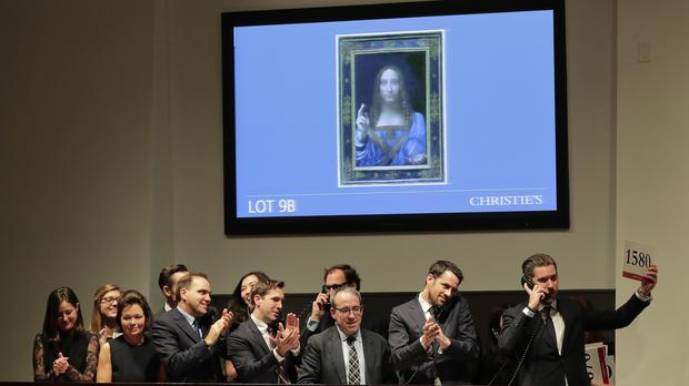 Bidding representatives react at the auction of Leonardo da Vinci's Salvator Mundi (AP)