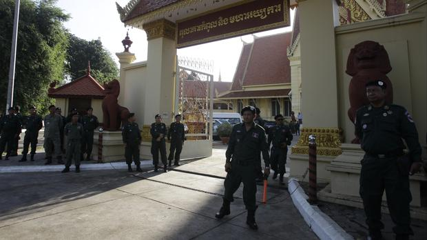 Security personnel guard the Supreme Court during its hearing in the crucial case to dissolve the country's main opposition Cambodia National Rescue Party (Heng Sinith/AP/PA)
