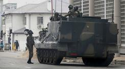A military vehicle is seen on a street in Harare (AP/PA)
