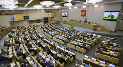 Lawmakers in the lower house of the Russian Parliament approved a bill allowing the government to register international media outlets as foreign agents (Alexander Zemlianichenko/AP/PA)