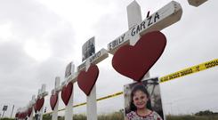 Crosses showing the names of shooting victims stand near the First Baptist Church in Sutherland Springs, Texas (David J Phillip/AP/PA)