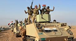 Iraqi security forces celebrate in Rawah (AP)