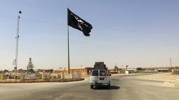The flag of the Islamic State group in central Rawah (AP)