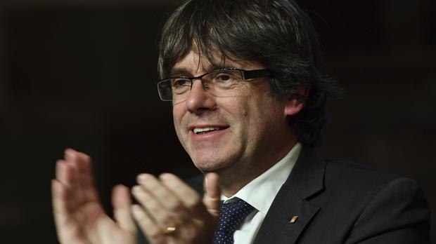 The Belgian government says it cannot intervene in Spain's extradition request against Carles Puigdemont (AP)