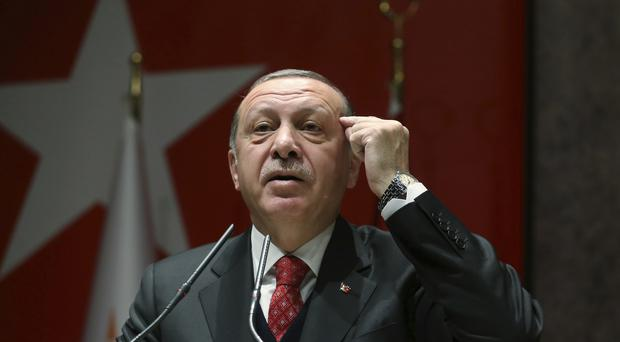 Turkey's President Recep Tayyip Erdogan addresses to his ruling party's provincial leaders