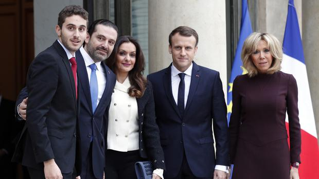Emmanuel Macron, centre right, and his wife Brigitte, greet Saad Hariri, second left, his wife Lara, and their son Hussam at the Elysee Palace in Paris (AP Photo/Christophe Ena)