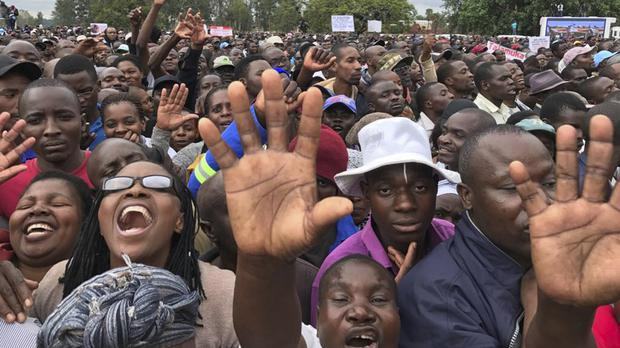 People demonstrating against Robert Mugabe in Harare (AP Photo/Ben Curtis)