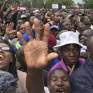 People begin to gather in Harare to demonstrate against Robert Mugabe (AP Photo/Christopher Torchia)
