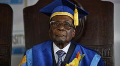 Robert Mugabe made his first public appearance since the military takeover at a student graduation ceremony at Zimbabwe Open University (AP Photo/Ben Curtis)