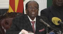 Zimbabwean president Robert Mugabe delivers his speech during a live broadcast (AP)
