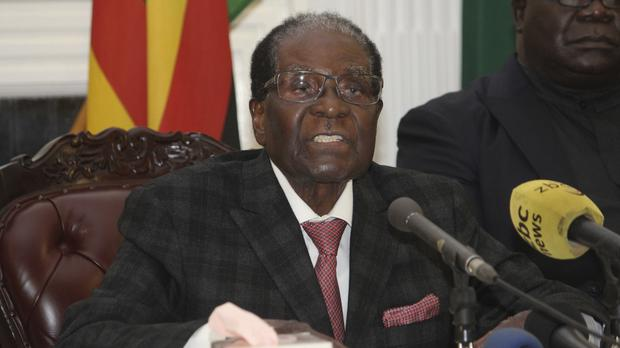 Robert Mugabe delivers his speech during a live broadcast at State House in Harare (AP)