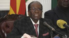 Zimbabwean president Robert Mugabe delivers his speech during a live broadcast at State House in Harare (AP)