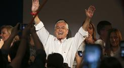 Former Chilean President Sebastian Pinera celebrates the first official results that place him in first place in the elections, in Santiago (AP)