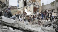 File photo of people inspecting the rubble of houses destroyed by Saudi-led airstrikes in Sanaa, Yemen (AP)
