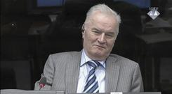 File picture of Ratko Mladic smiling during an appearance at the Yugoslav war crimes tribunal in The Hague, Netherlands (AP)