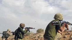 Syrian pro-government troops on the Iraq-Syria border (Syrian Central Military Media/AP)