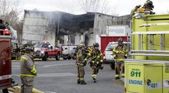 Firefighters work at the scene of a factory fire in New Windsor (AP)