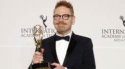 Actor Kenneth Branagh poses with the award for best performance by an actor in Wallander (Andy Kropa/Invision/AP)