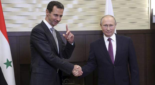 Vladimir Putin indicates end to Russian action in Syria as he meets Bashar Assad