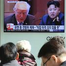 Commuters watch US president Donald Trump and North Korean leader Kim Jong Un on TV in Seoul, South Korea (Ahn Young-joon/AP)