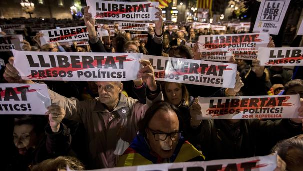 Protesters call for 'freedom for political prisoners' during a demonstration in front of the Palau Generalitat in Barcelona (Emilio Morenatti/AP)