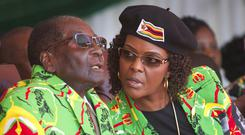 Robert Mugabe and his wife Grace (AP)