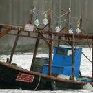 A wooden boat is seen at a marina, in Yurihonjo, Akita prefecture, northern Japan (AP)