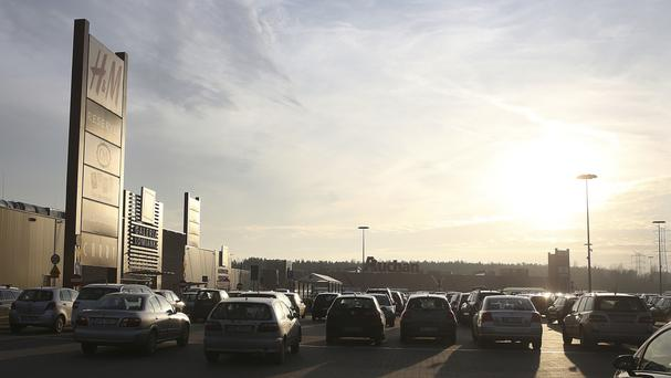 A view of a packed car park at a popular shopping mall in Lomianki, near Warsaw, in Poland, on Black Friday. (AP Photo/Czarek Sokolowski)