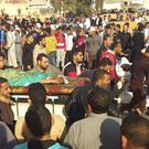 Injured people are evacuated from the scene of the attack in the northern Sinai Peninsula (AP)