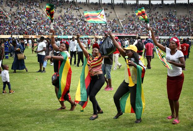 CELEBRATION: The new joyous mood of Zimbabwe is reflected after the swearing in of President Emmerson Mnangagwa in Harare Pic: Reuters