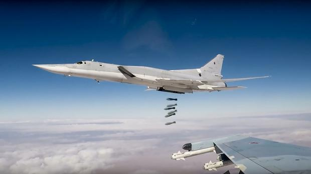 Russian Tu-22M3 long-range bombers strike Islamic State targets in Syria (Russian Defence Ministry Press Service/AP)
