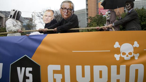 Demonstrators in front of the EU headquarters in Brussels (AP)