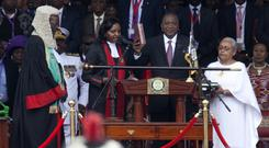 Uhuru Kenyatta is sworn in during his inauguration ceremony at Kasarani stadium in Nairobi (AP)