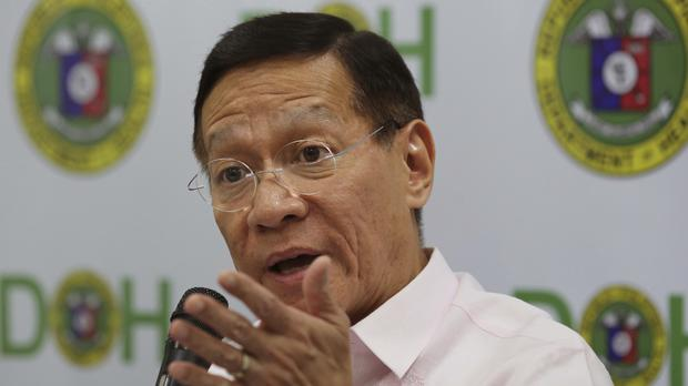 Philippines Health Secretary Francisco Duque III answers questions from reporters in Manila after the country put its dengue immunisation programme on hold (AP Photo/Aaron Favila)