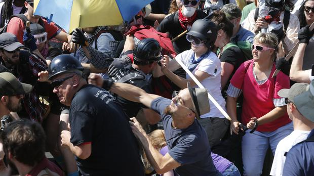 White nationalists clashed with counter-protesters in Charlottesville on August 12 (AP)